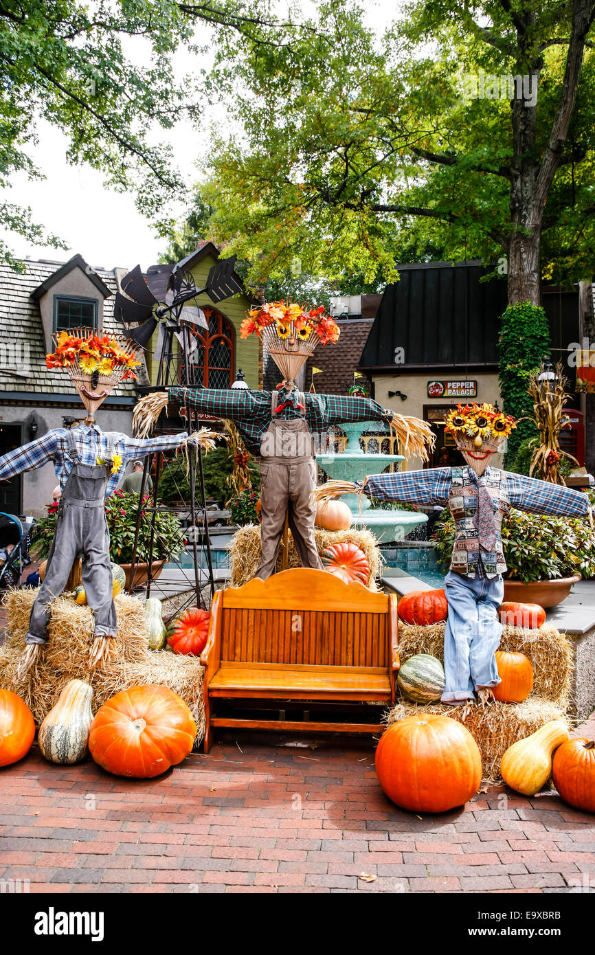 october sees halloween scarecrows pumpkins and the fall in stock