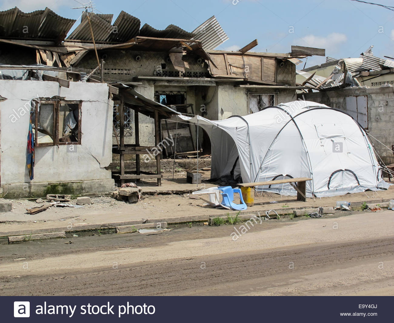 A disaster relief tent erected next to a badly damaged tent in Brazzaville. Congo after an explosion made 14000 homeless & A disaster relief tent erected next to a badly damaged tent in ...
