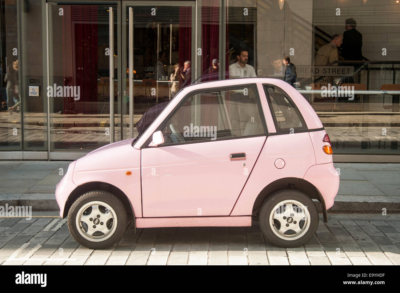 Pink Electric G Wiz Car Parked In A London Street Stock Photo