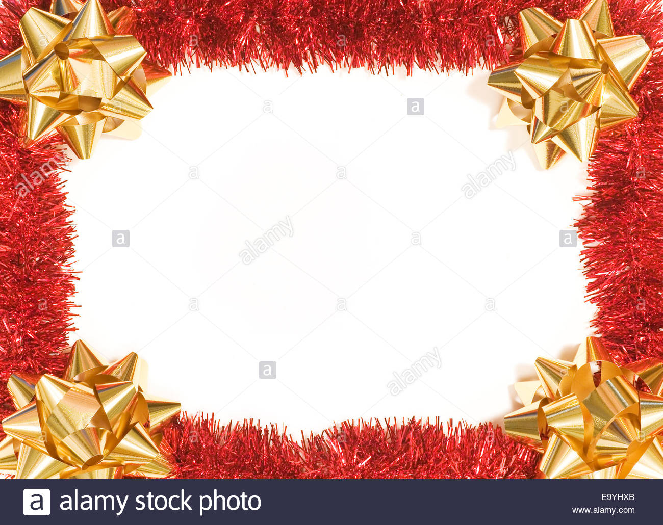 Red Tinsel and gold bows as a Christmas background to frame your ...