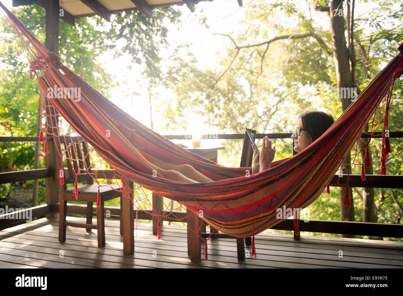 a woman relaxing in a hammock  montezuma costa rica a woman relaxing in a hammock  montezuma costa rica stock photo      rh   alamy