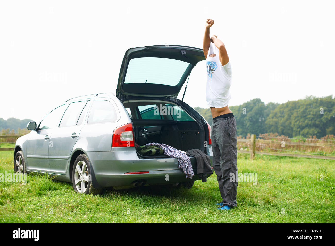 Changing clothes in a car - Man At Rear Of Car Changing Clothes