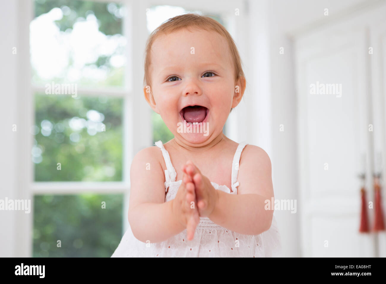 Baby girl clapping hands, portrait Stock Photo, Royalty ...