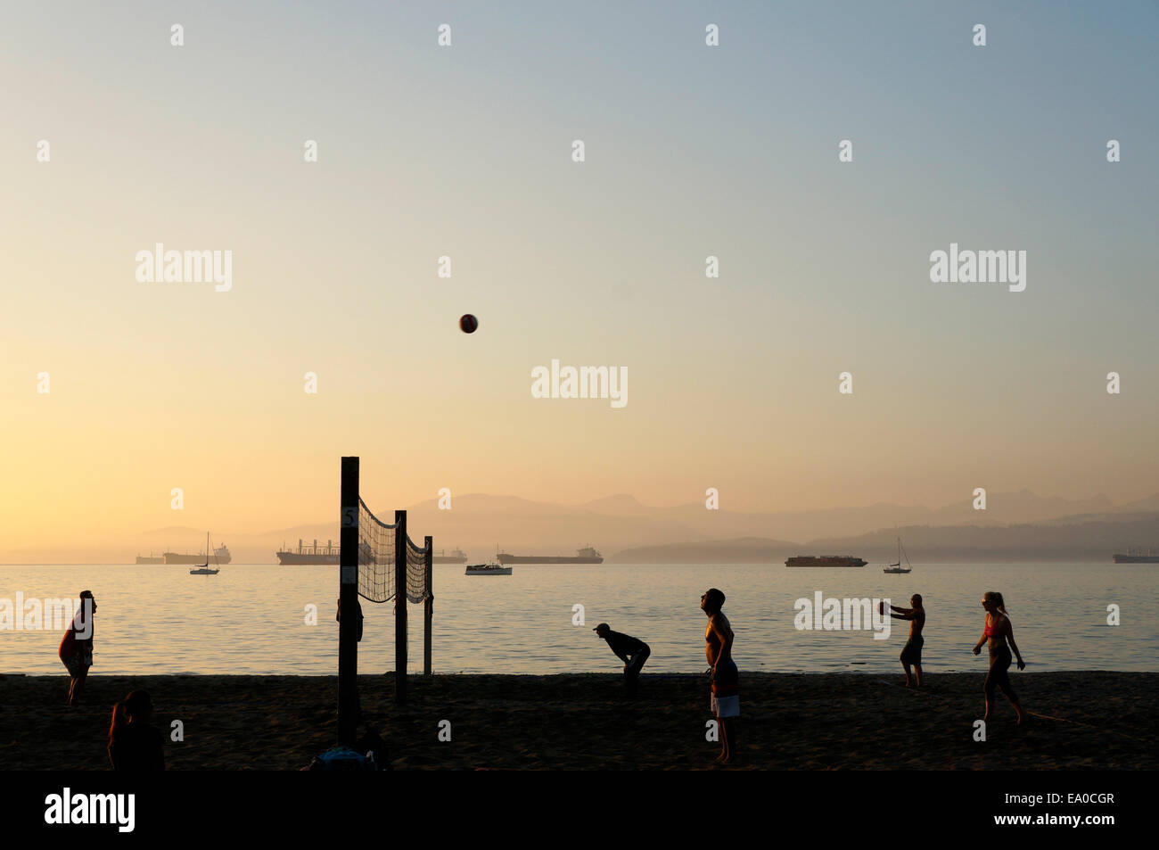 people-playing-beach-volleyball-at-sunse
