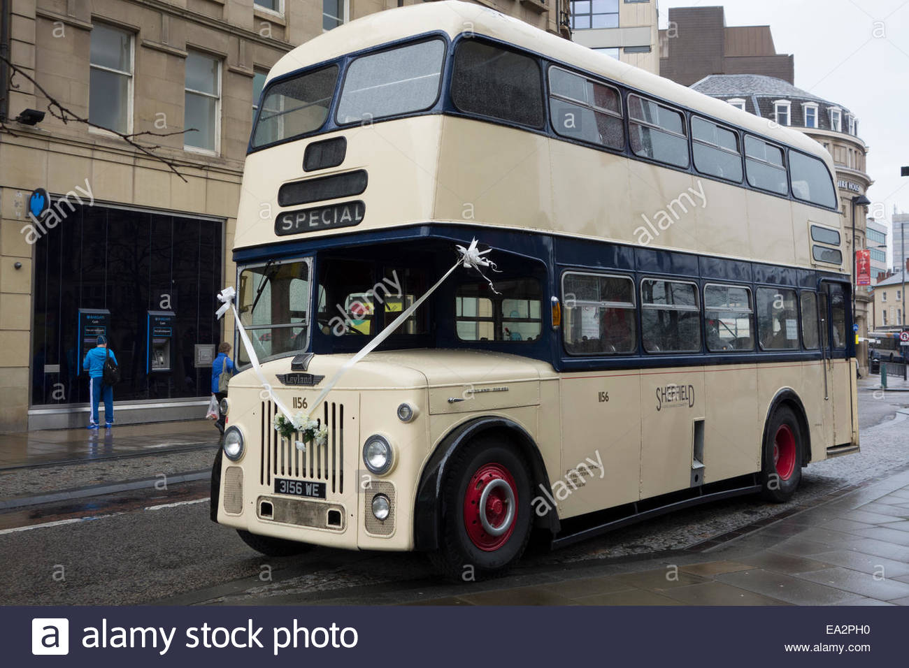 White Or Cream Decorated Double Decker Bus Being Used As Wedding Transport In Sheffield England
