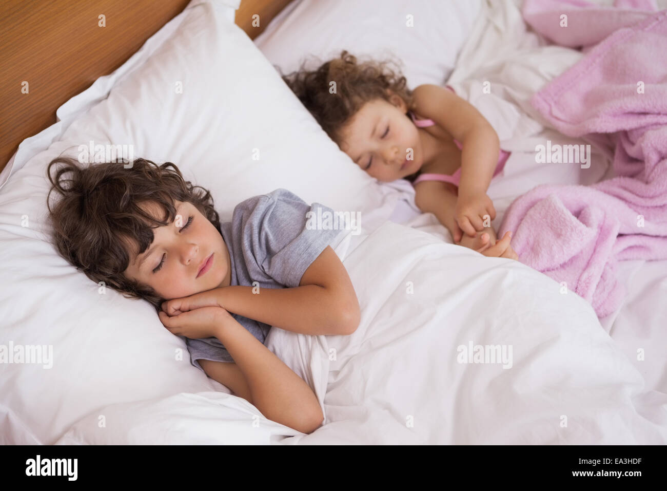 Young girl and boy sleeping in bed stock photo royalty for Sleeping bed