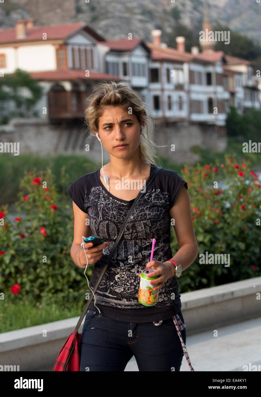 Modern Turkish Girl Strolling In Riverside Park, Amasya, Turkey