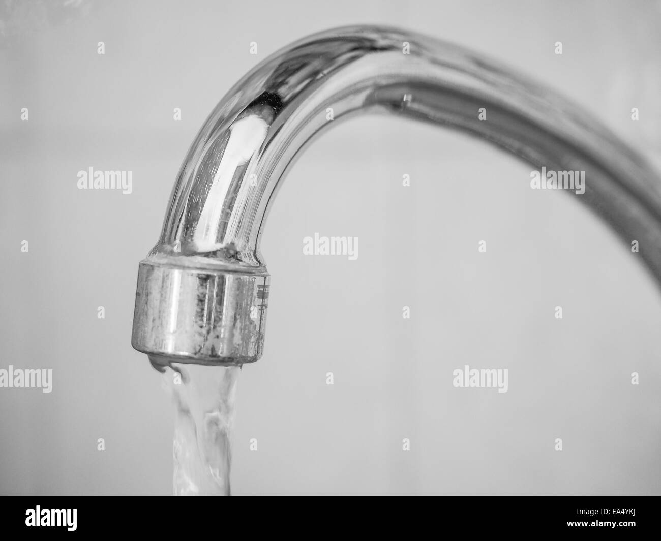 Kitchen sink tap with flowing water Stock Photo, Royalty Free ...