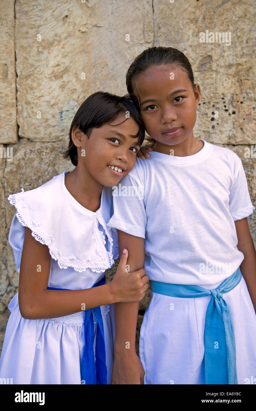 Two preteen filipino girls in white dresses ready for catholic two preteen filipino girls in white dresses ready for catholic church mass at dimiao town bohol island philippines thecheapjerseys Choice Image