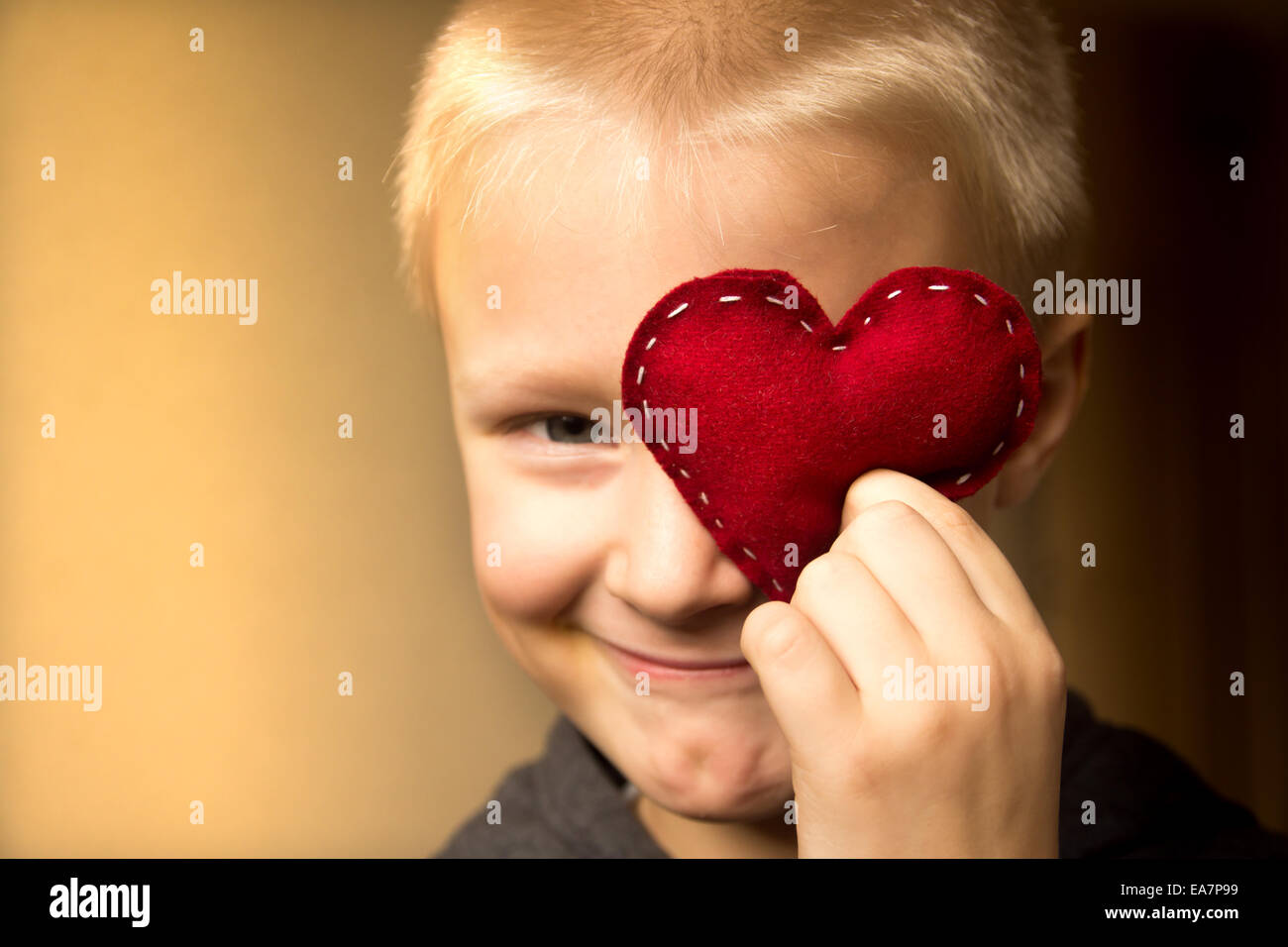 Happy cute child (kid, boy) with hand made red heart. Valentines ...