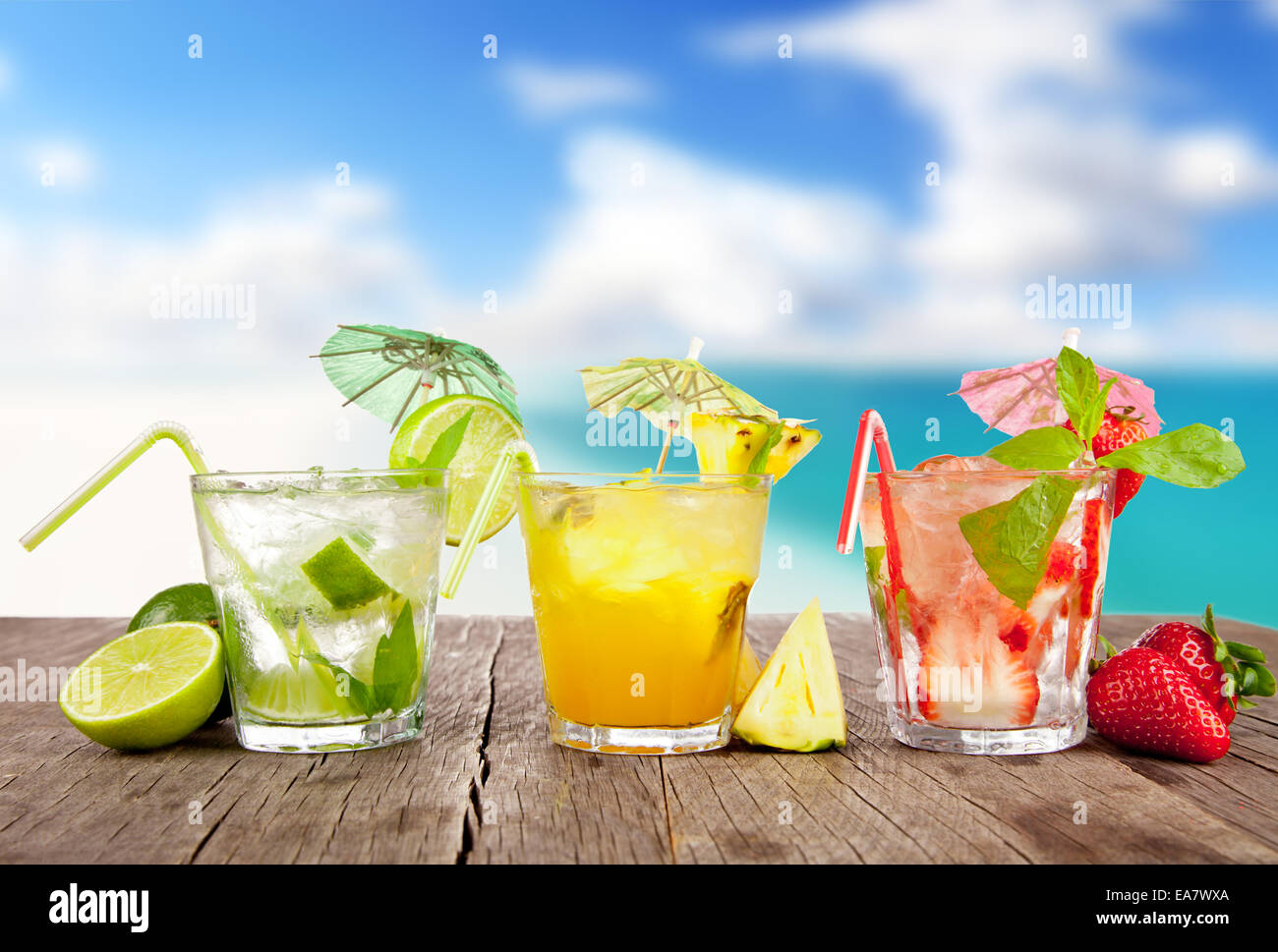 Fresh Summer Drinks On Wooden Table With Blur Sea