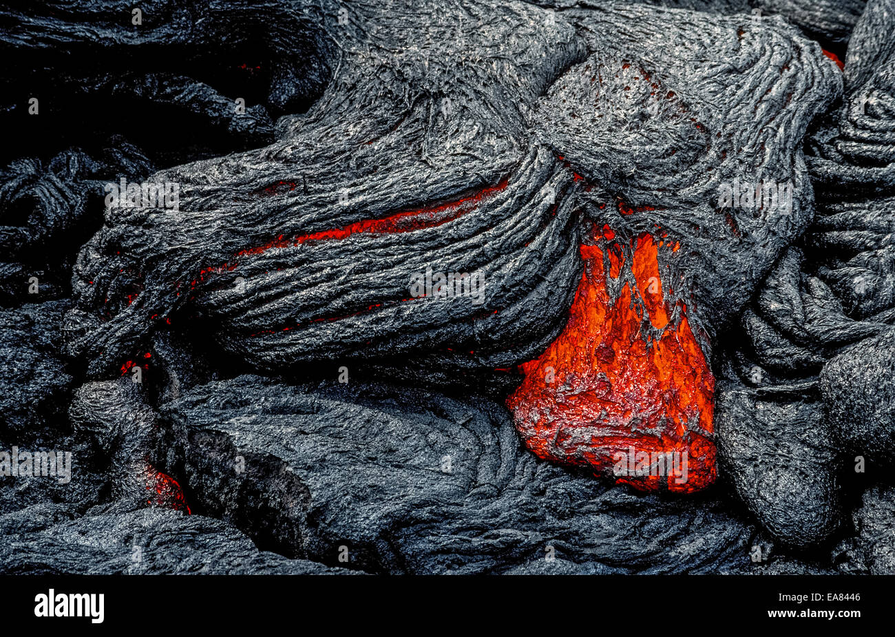 molten lava rock that glows from its extreme heat flows