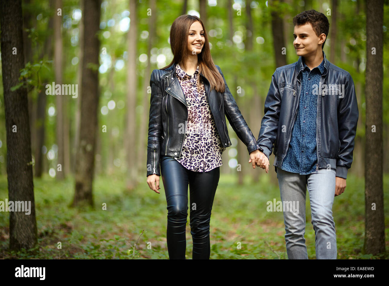 Teenagers Boy And Girl On A Date Taking A Walk Through