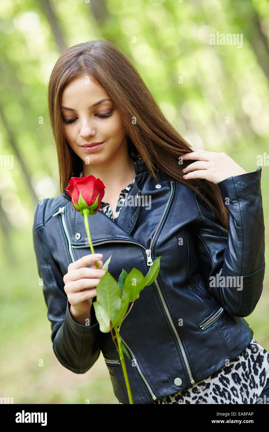 fap teen girls Beautiful teen girl with a red rose outdoor in the forest - Stock Image