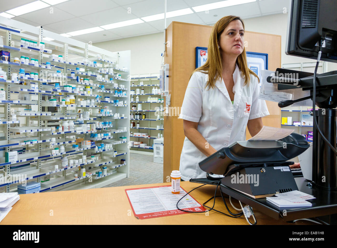 walgreens employee stock photos walgreens employee stock images miami beach florida walgreens pharmacy drugstore pharmacist w filling prescription employee job stock image