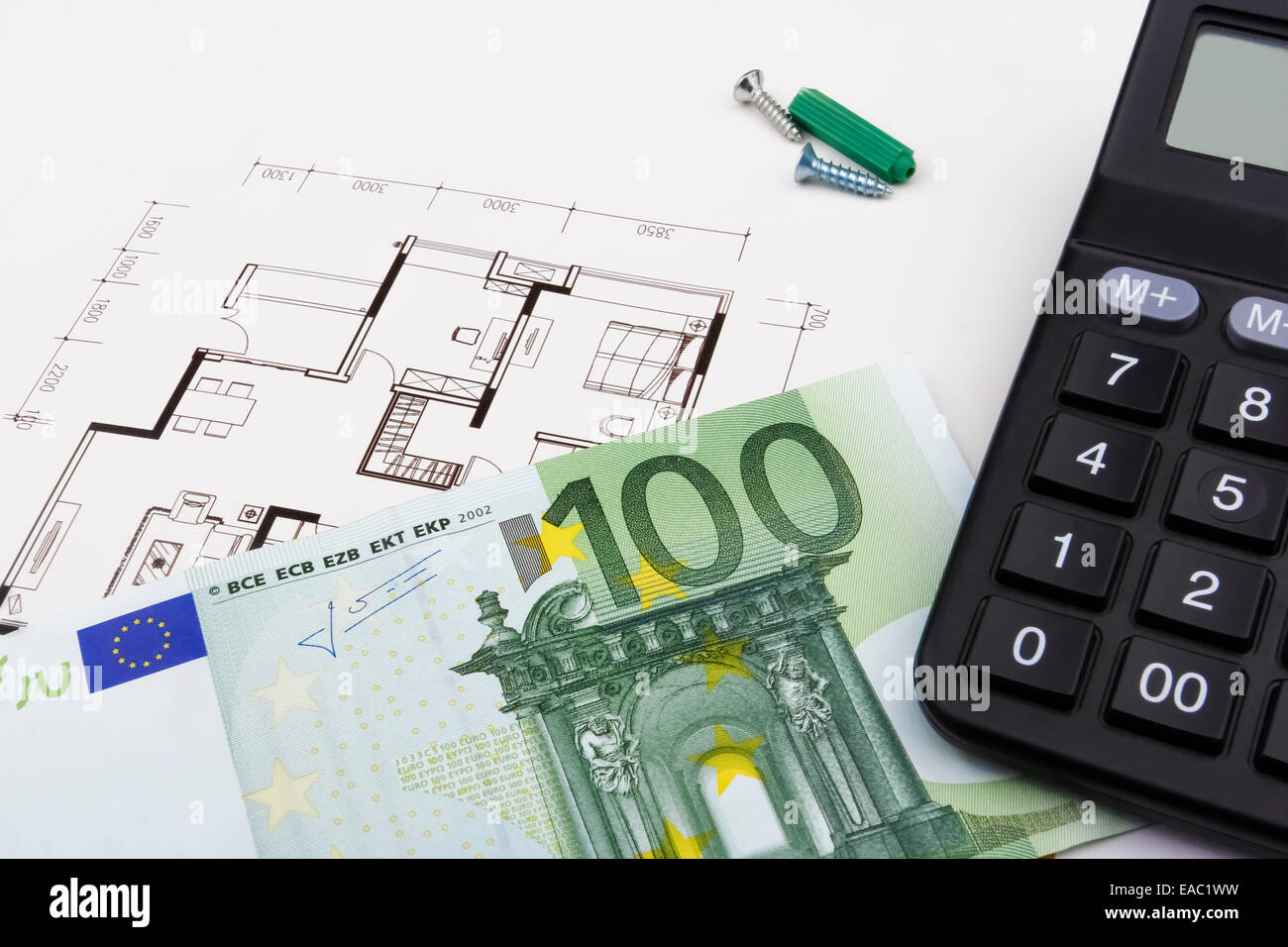 Construction concept with a 100 euro bill a blueprint and a stock construction concept with a 100 euro bill a blueprint and a caculator malvernweather Image collections