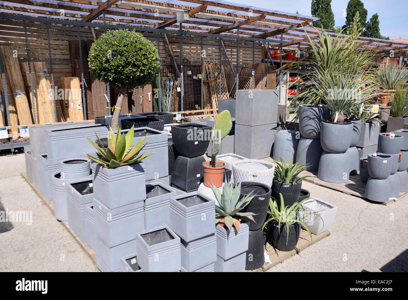 garden plant pots for sale. display of gray or grey planters plant pots for sale in garden center centre