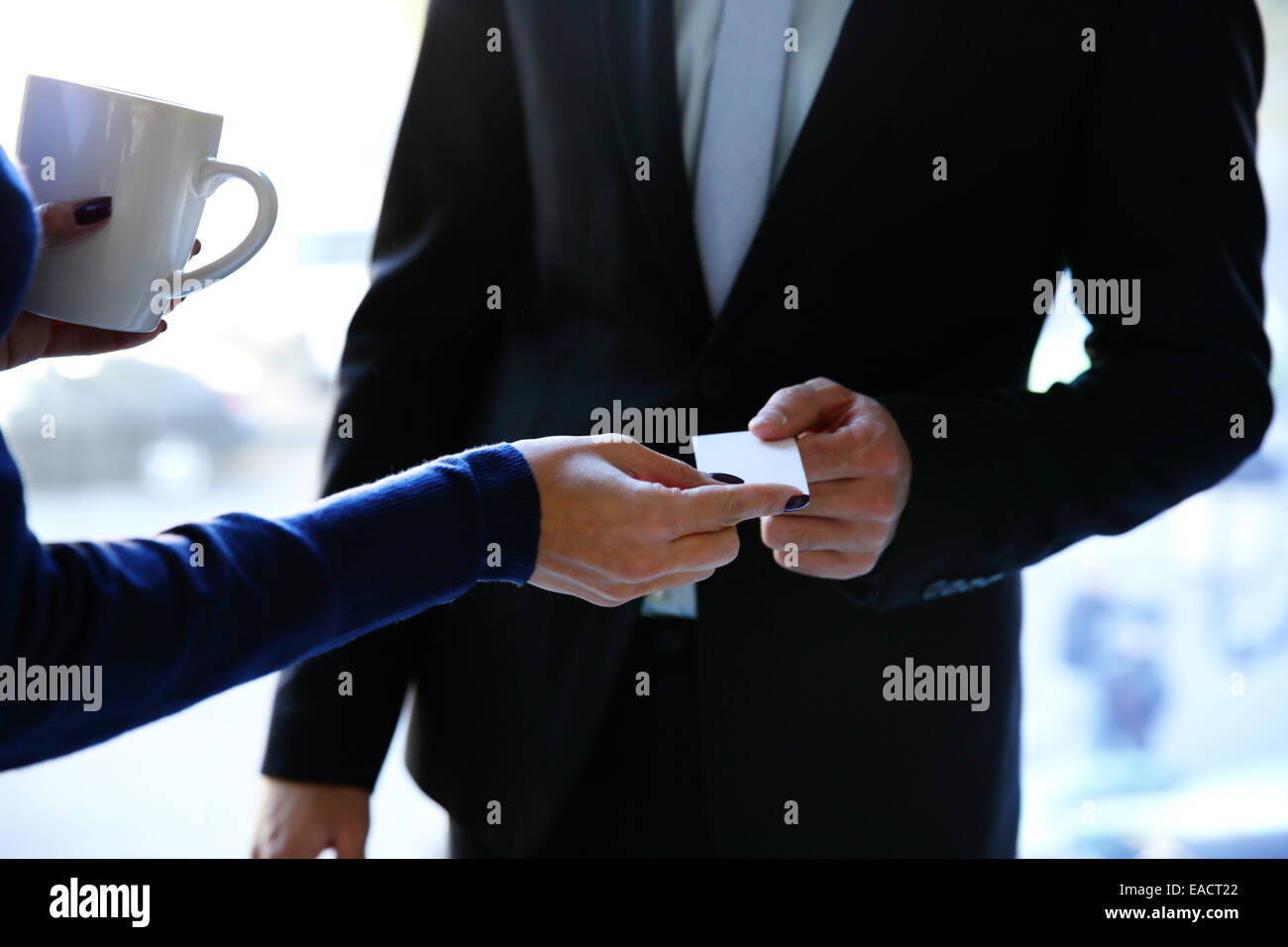 Concept shot of exchange business card between man and woman Stock ...