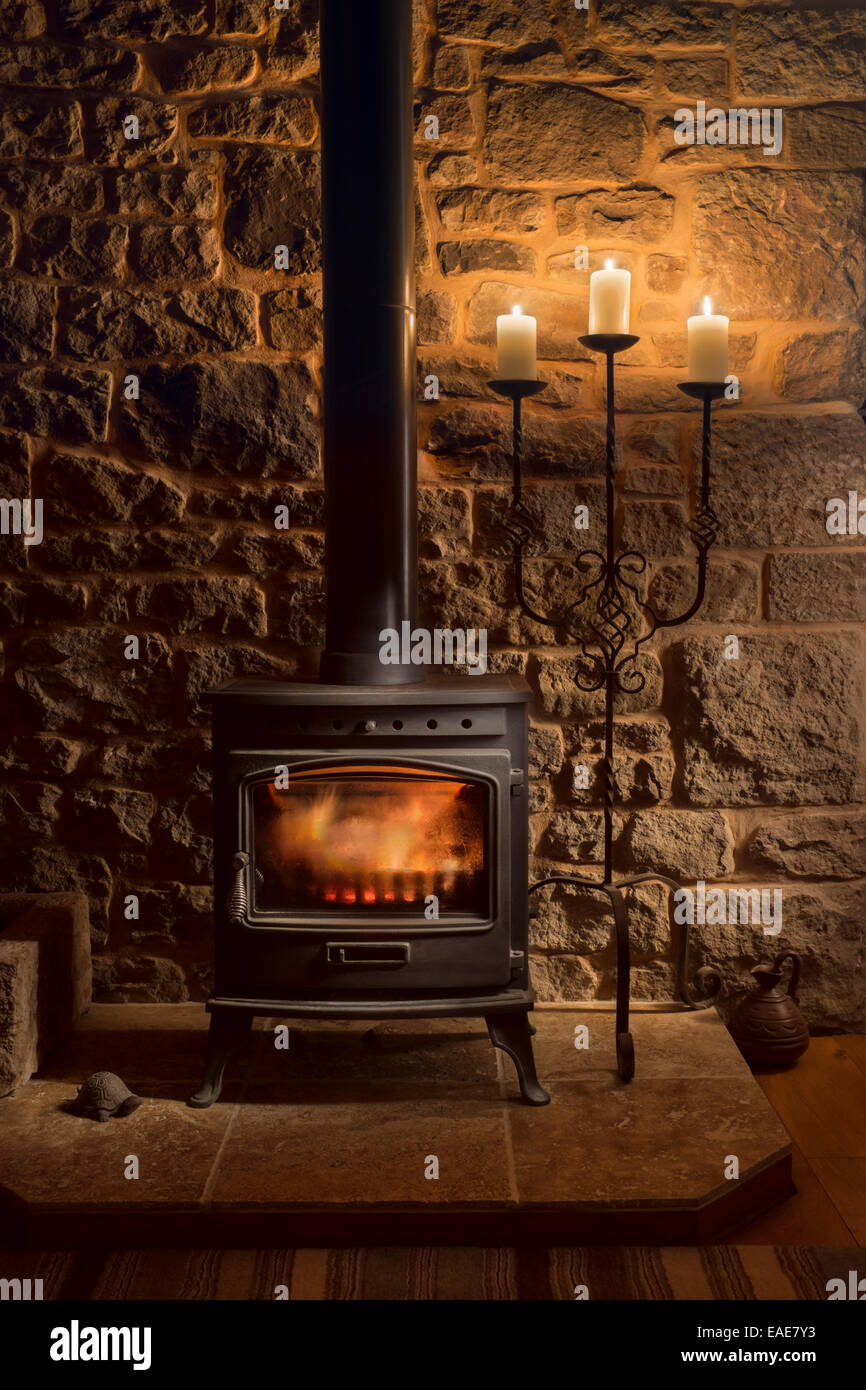 wood burning fireplace in cottage stock photo royalty free image