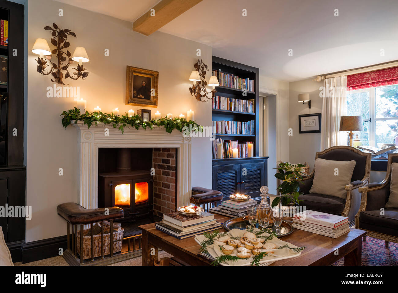 Woodburning stove with Georgian fire surround in living room with