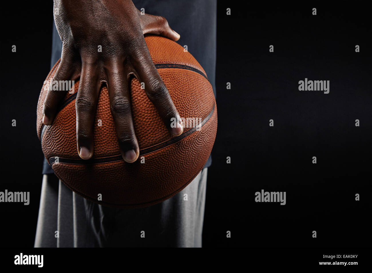 Close Up Of A Hand Of Basketball Player Holding A Ball