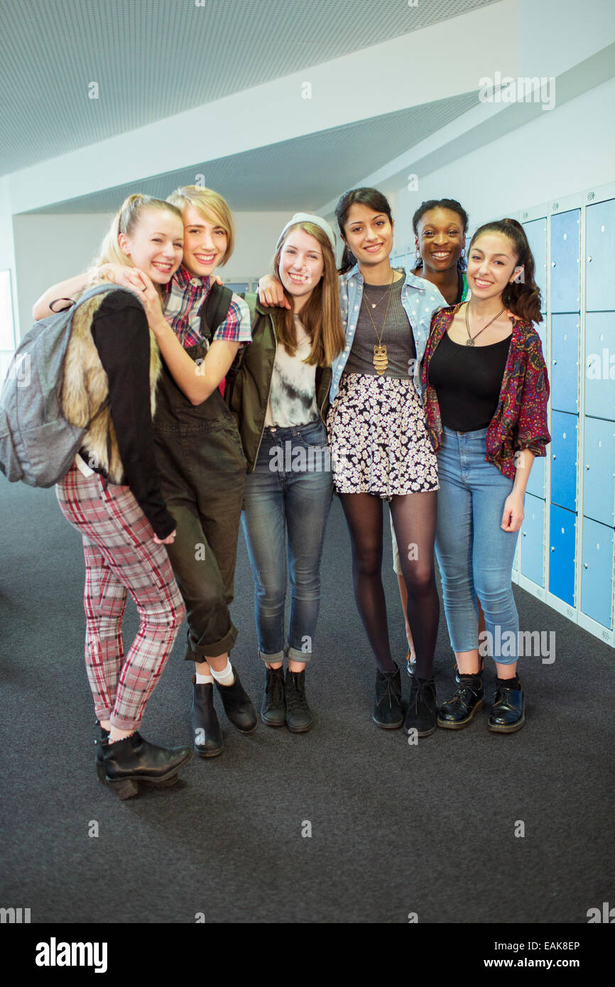 Group Of Teenage Girls Standing In Locker Room Portrait