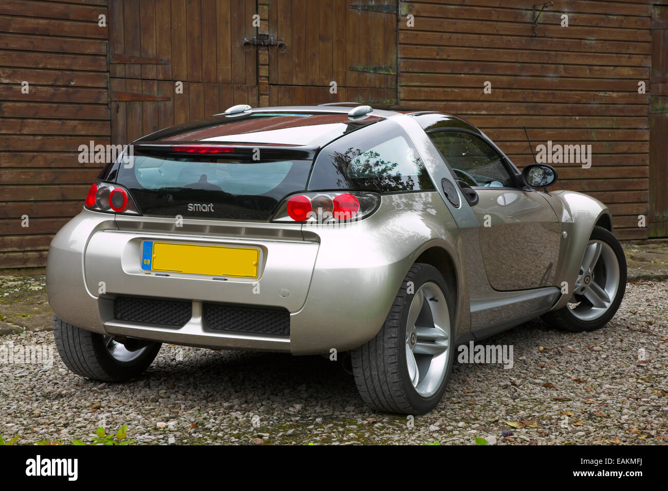 gold coloured smart roadster coupe car stock photo royalty free image 75421238 alamy. Black Bedroom Furniture Sets. Home Design Ideas