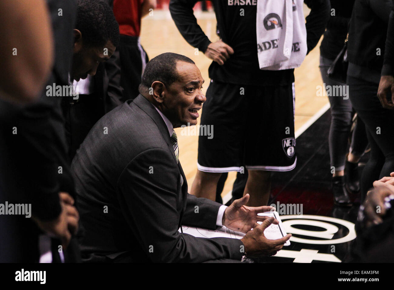 Brooklyn head coach LIONEL HOLLINS talks to his team during a time