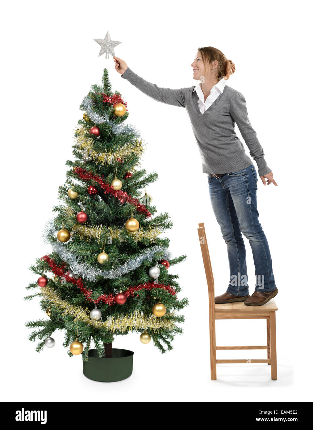Stock Photo  Woman Christmas Tree Decorating Ornaments Putting A Star On  The Tree Top