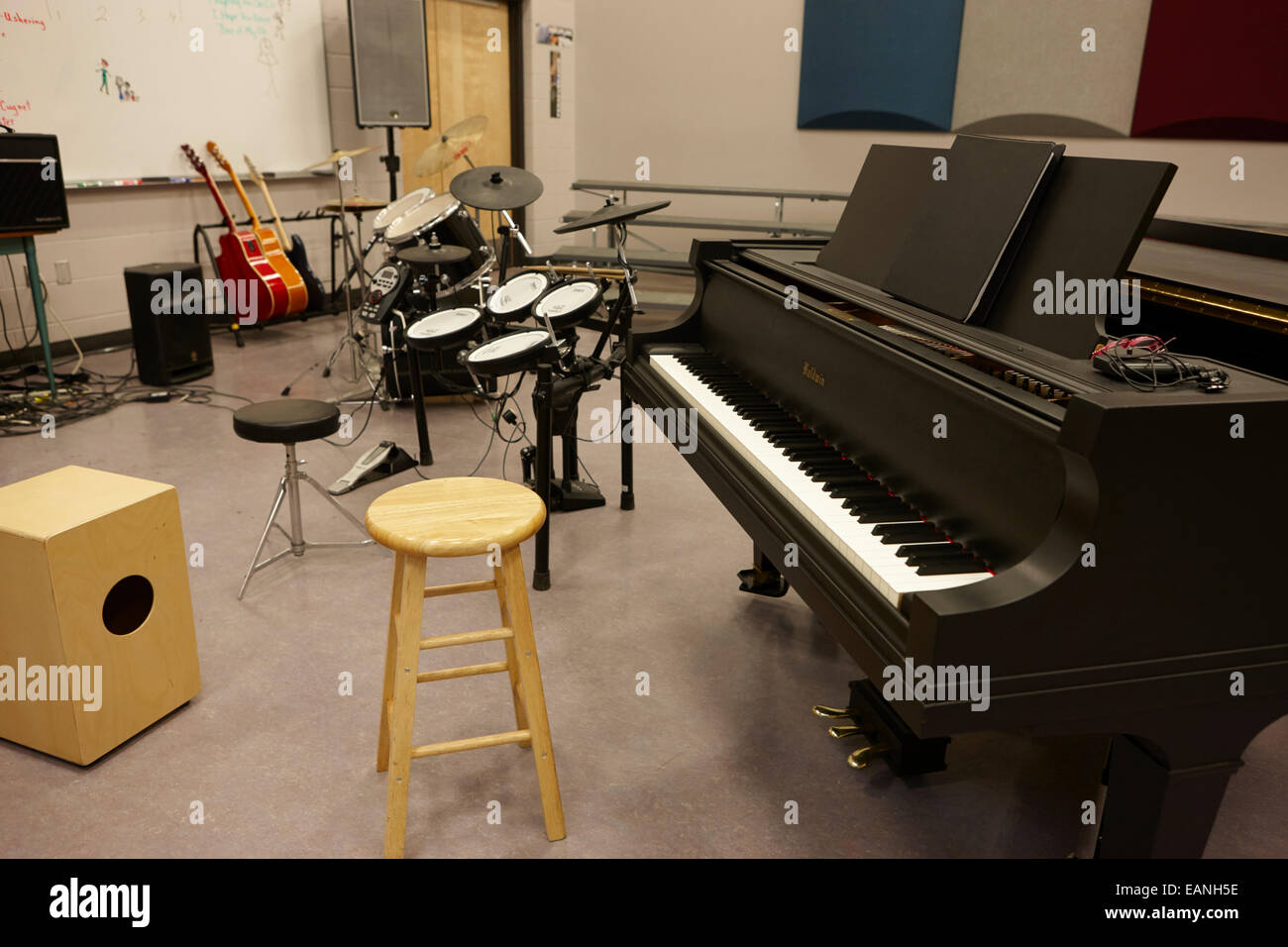 Empty room with chair violin and sheet music on floor photograph - Baby Grand Piano In A Music Training Room Stock Image