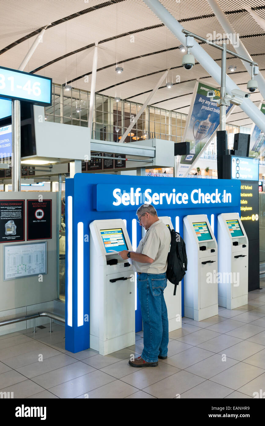 Passenger In Front Of Self Service Check In Terminal, Cape Town  International Airport, Western Cape, South Africa