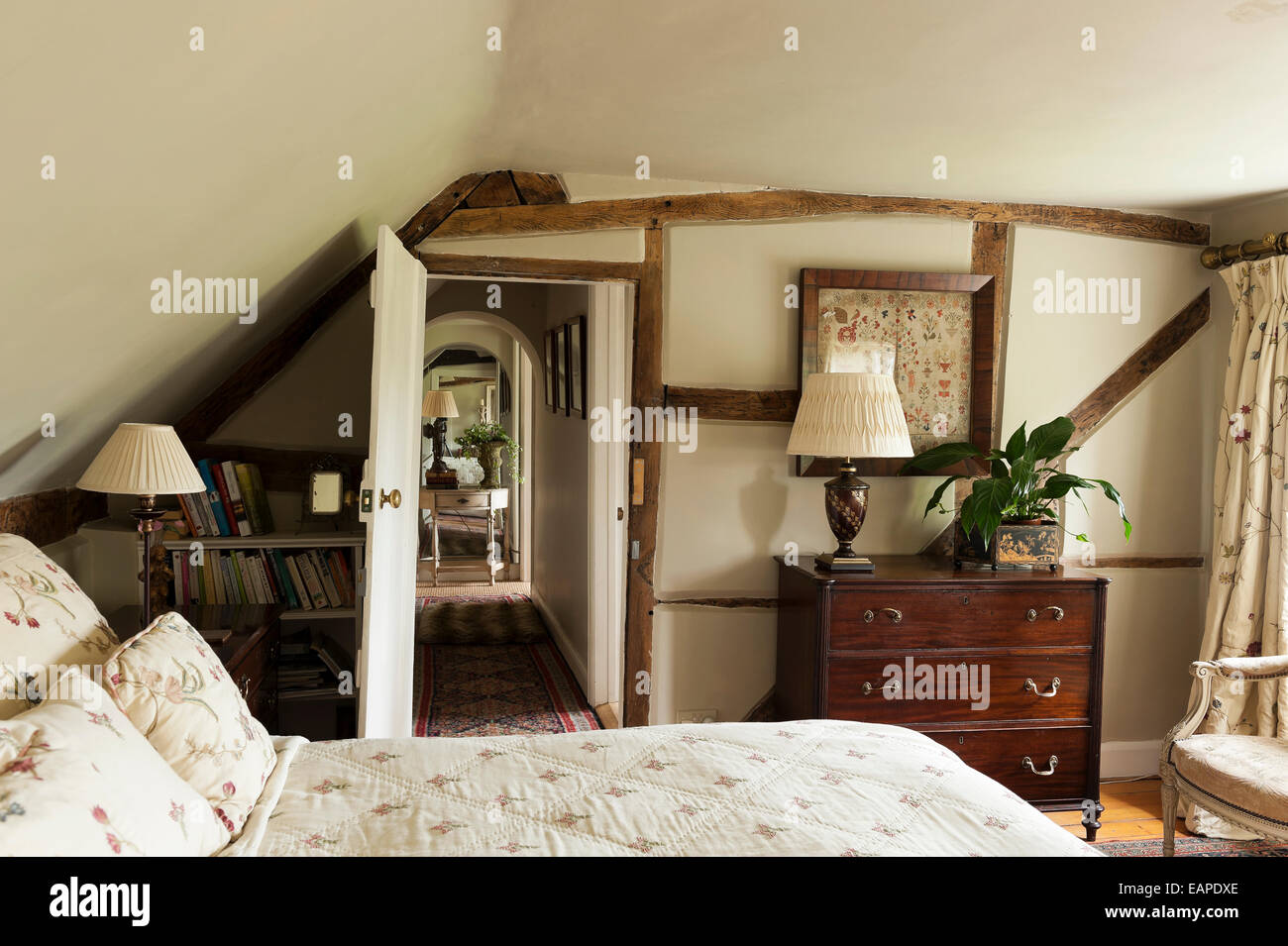 Small Cottage Bedroom Cottage Bedroom With Floral Quilt On White Wrought Iron Bed And