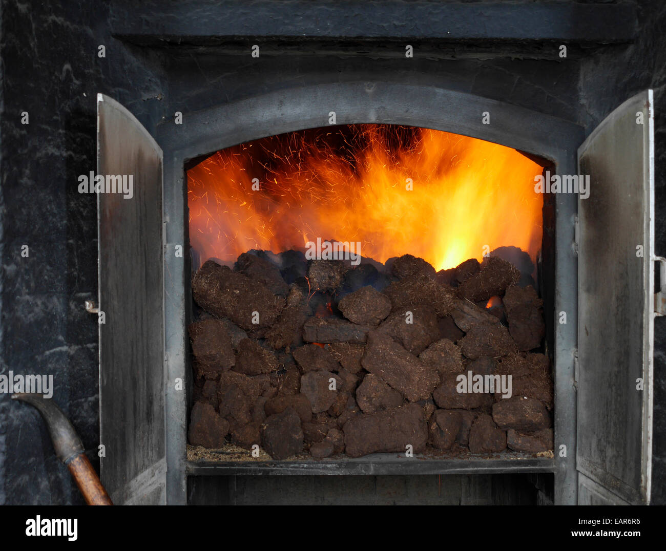 Peat burning at the Laphroaig Whisky Distillery on the island of ...