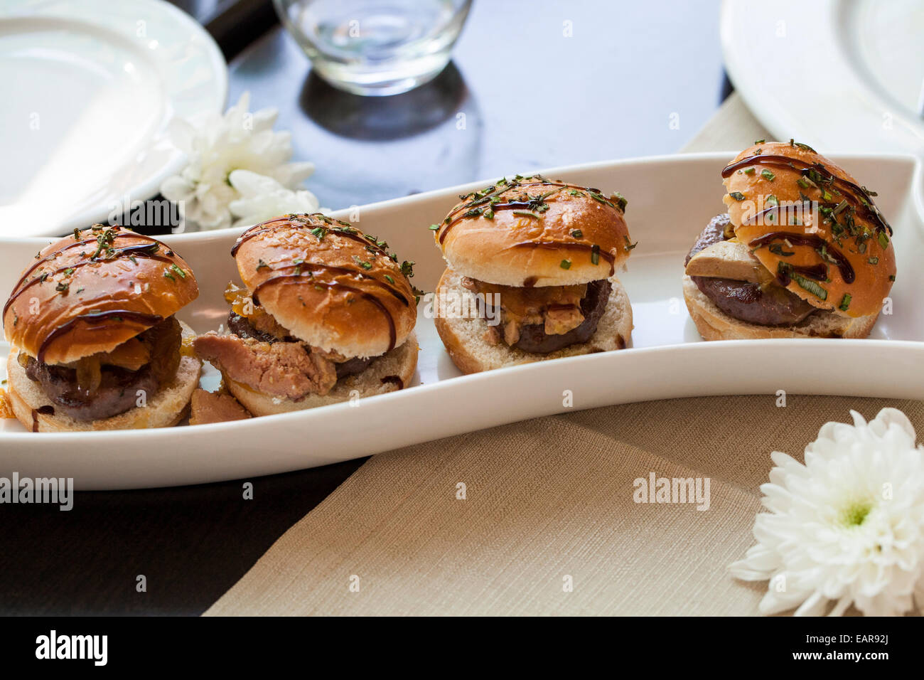 mini-beef-burgers-on-rolls-on-a-curved-p
