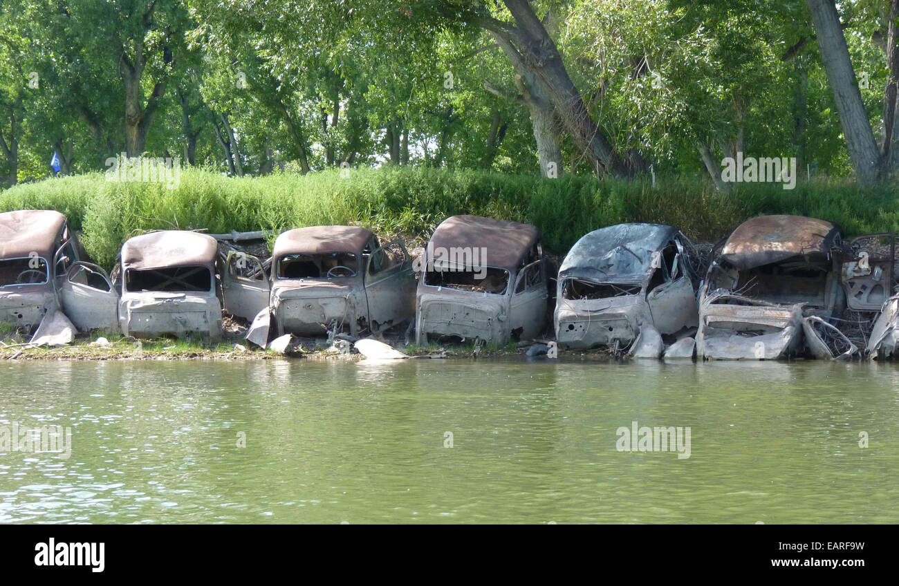 stock photo wrecked cars flood defences missouri river
