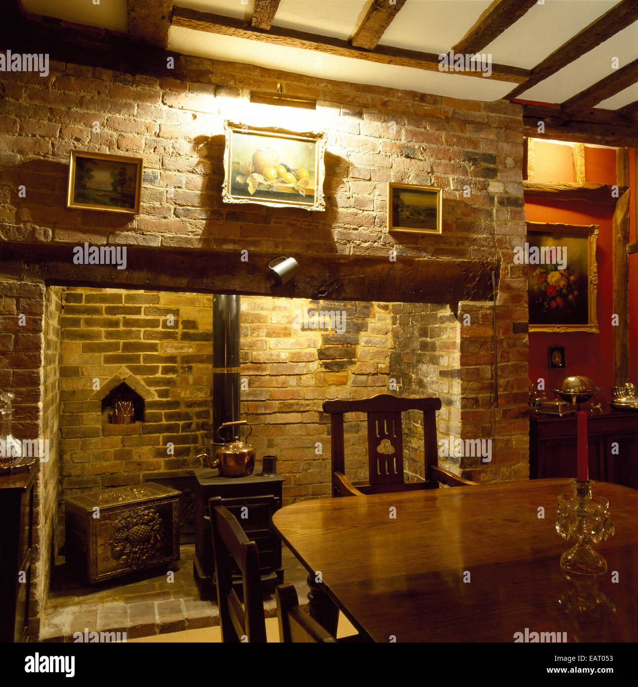 a traditional, country style dining room, inglenook fireplace
