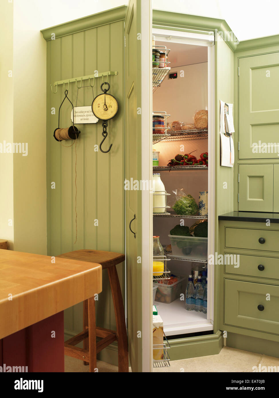 Walk in chilled larder pantry set in green kitchen unit for Kitchen unit set