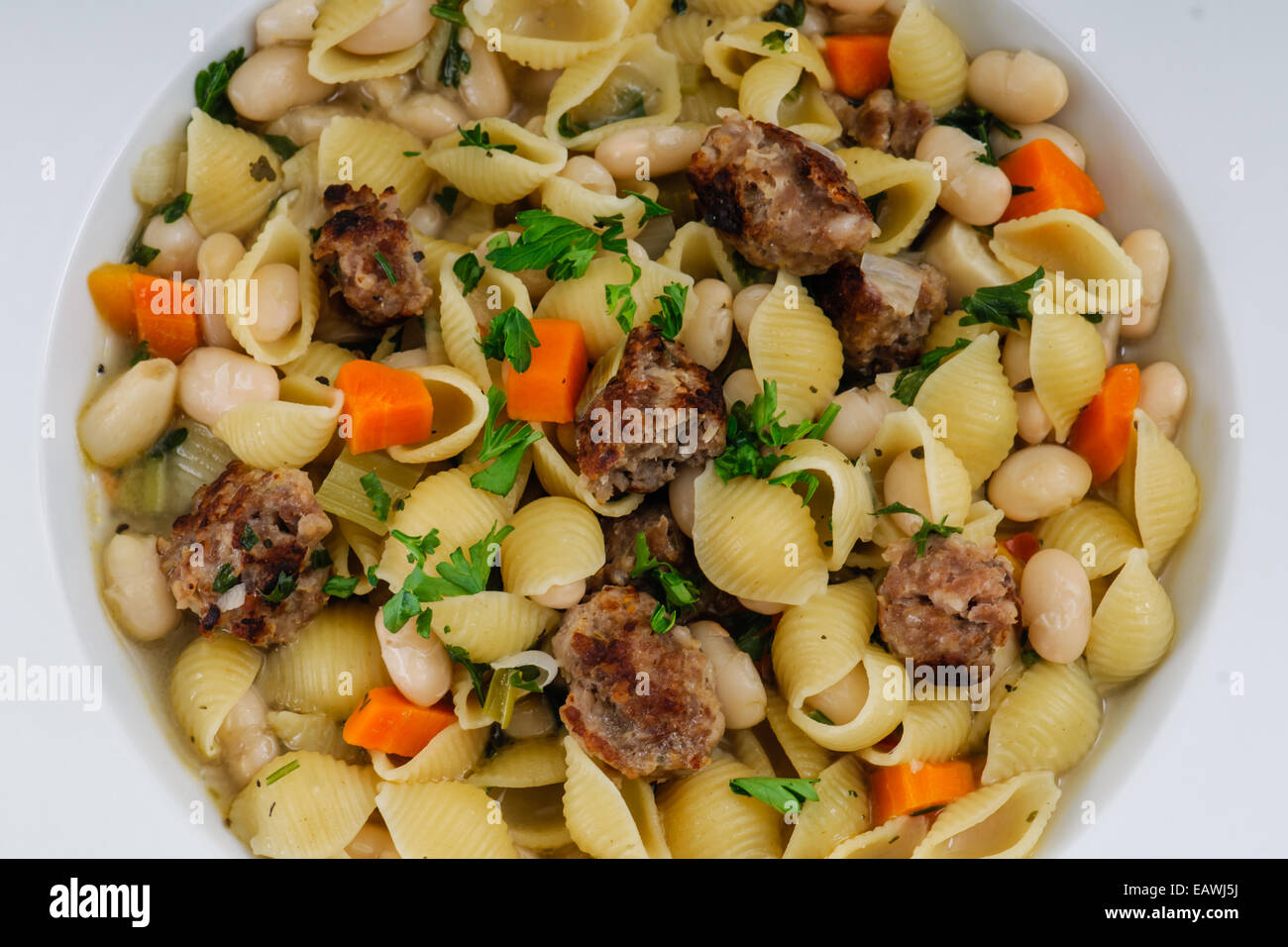 Hearty Dinner Of Italian Sausage, White Bean And Shell Pasta Soup
