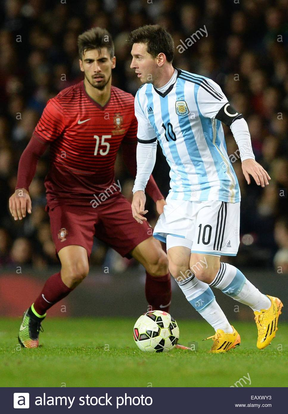 http://c8.alamy.com/comp/EAXWY3/epa04494978-argentinas-lionel-messi-r-goes-past-portugals-andre-gomes-EAXWY3.jpg