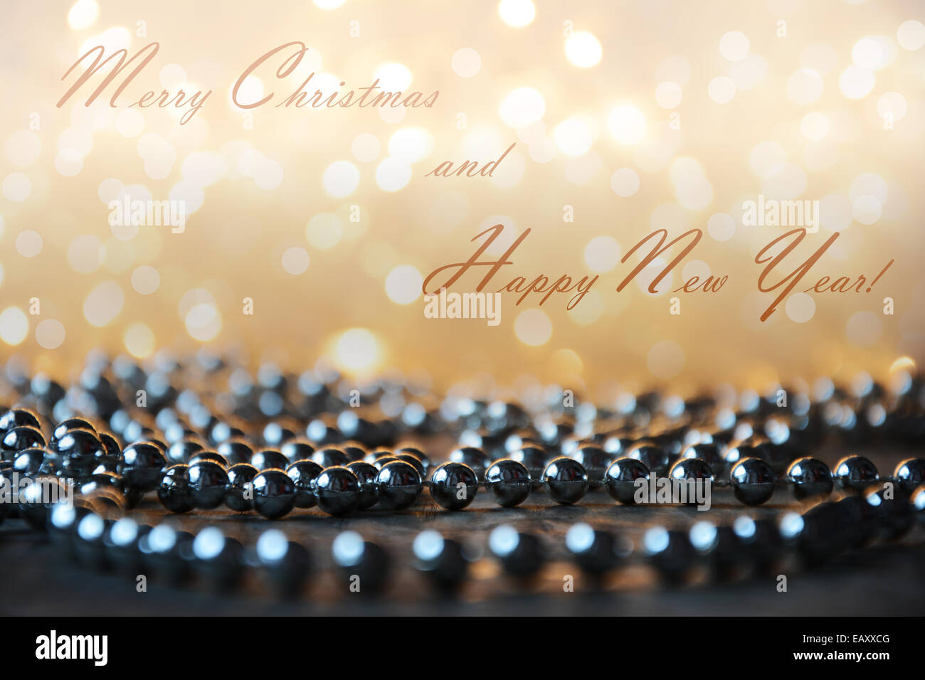 stock photo yellow christmas lights background with silver pearls on wooden floor and text effect - Pearl Christmas Lights