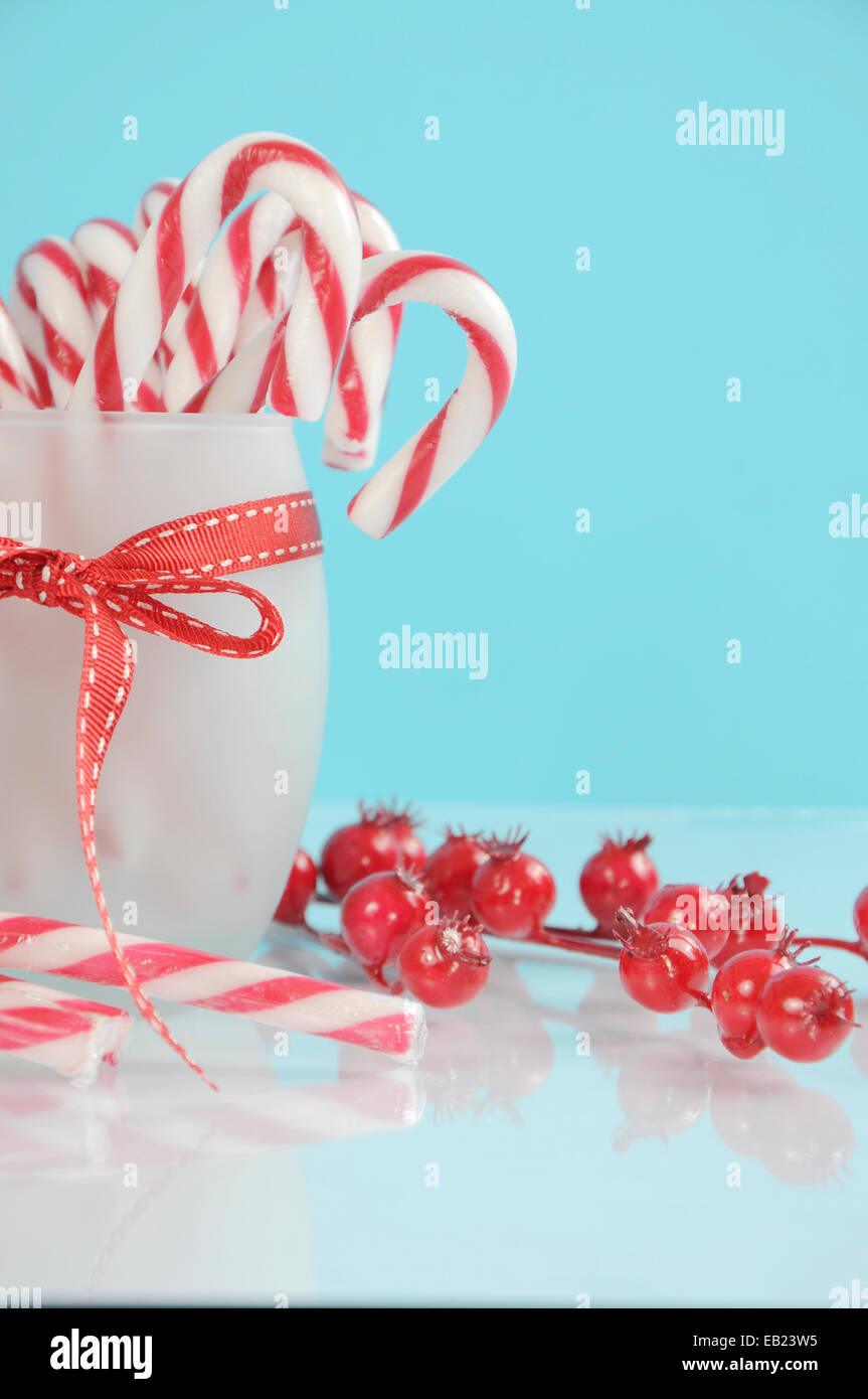 Christmas Holiday Dessert Party Candy Canes In Modern Red And White Trend On Pale Blue Background Vertical