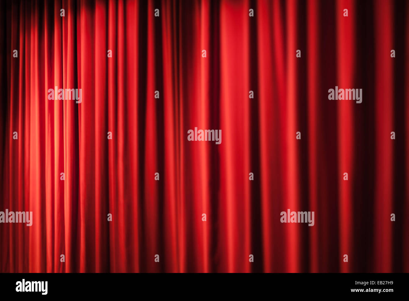 Closed theater curtains - Stock Photo A Closed Red Stage Curtain In A Small Theater