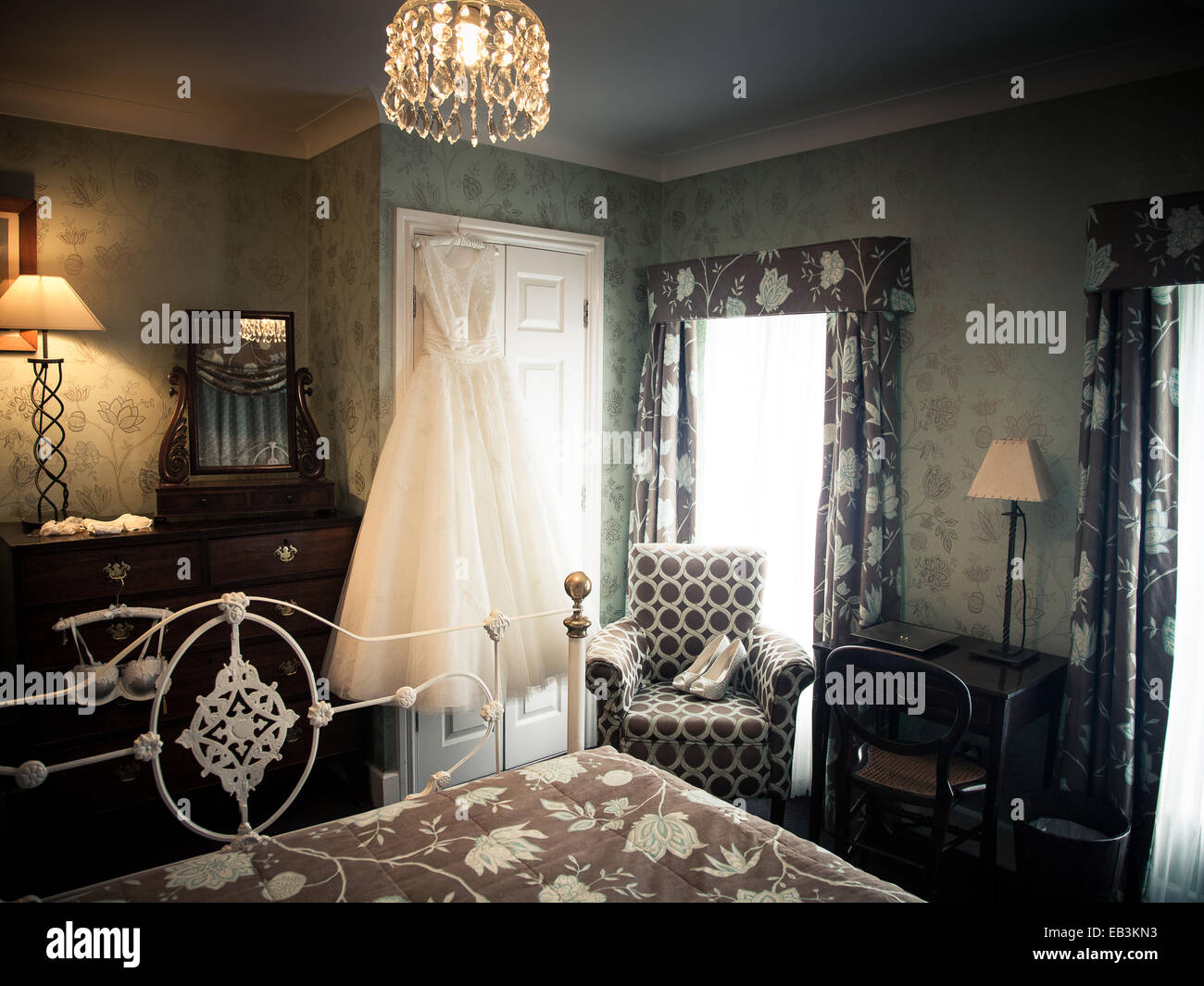 bridal suite, hotel room with wedding dress hanging and shoes on ...