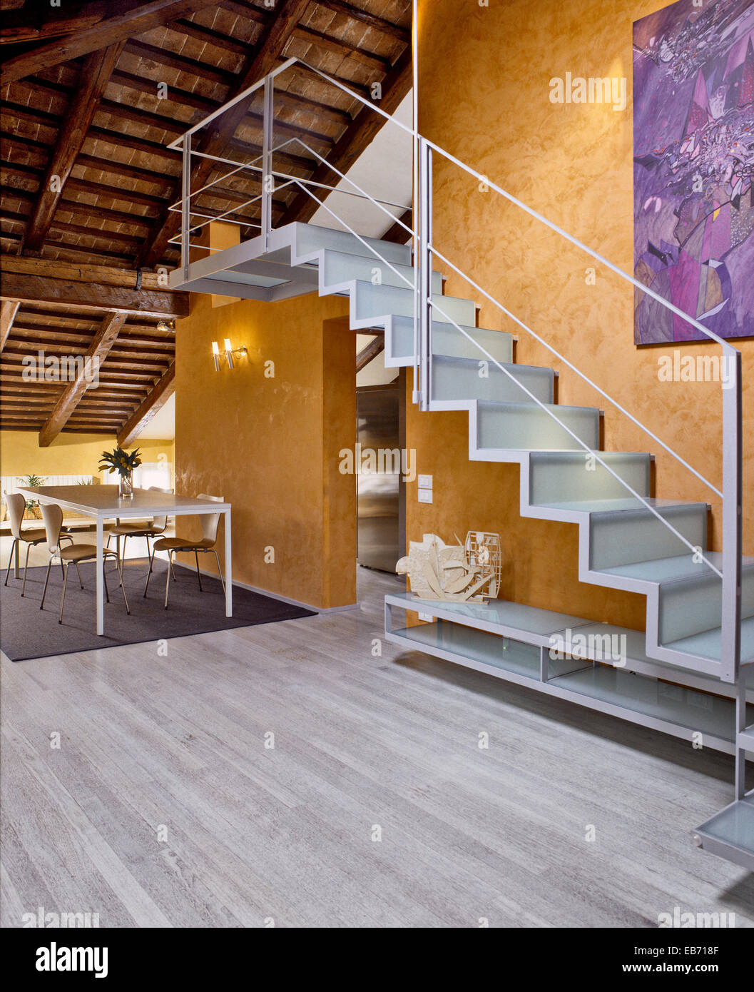 Interior View Of Entrance With Staircase Wood Floor And Dining