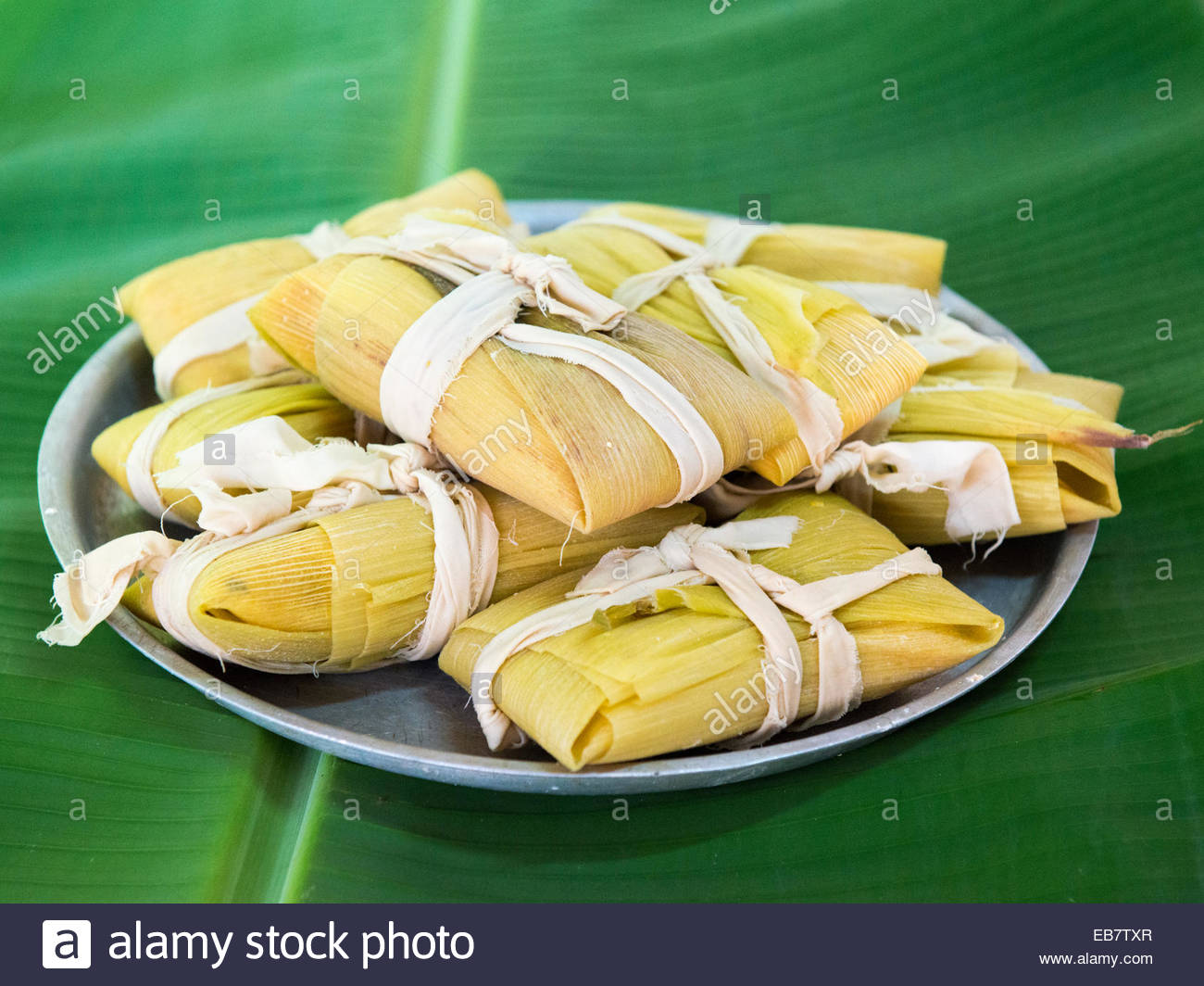 Traditional homemade corn tamales a popular latin america for Authentic cuban cuisine