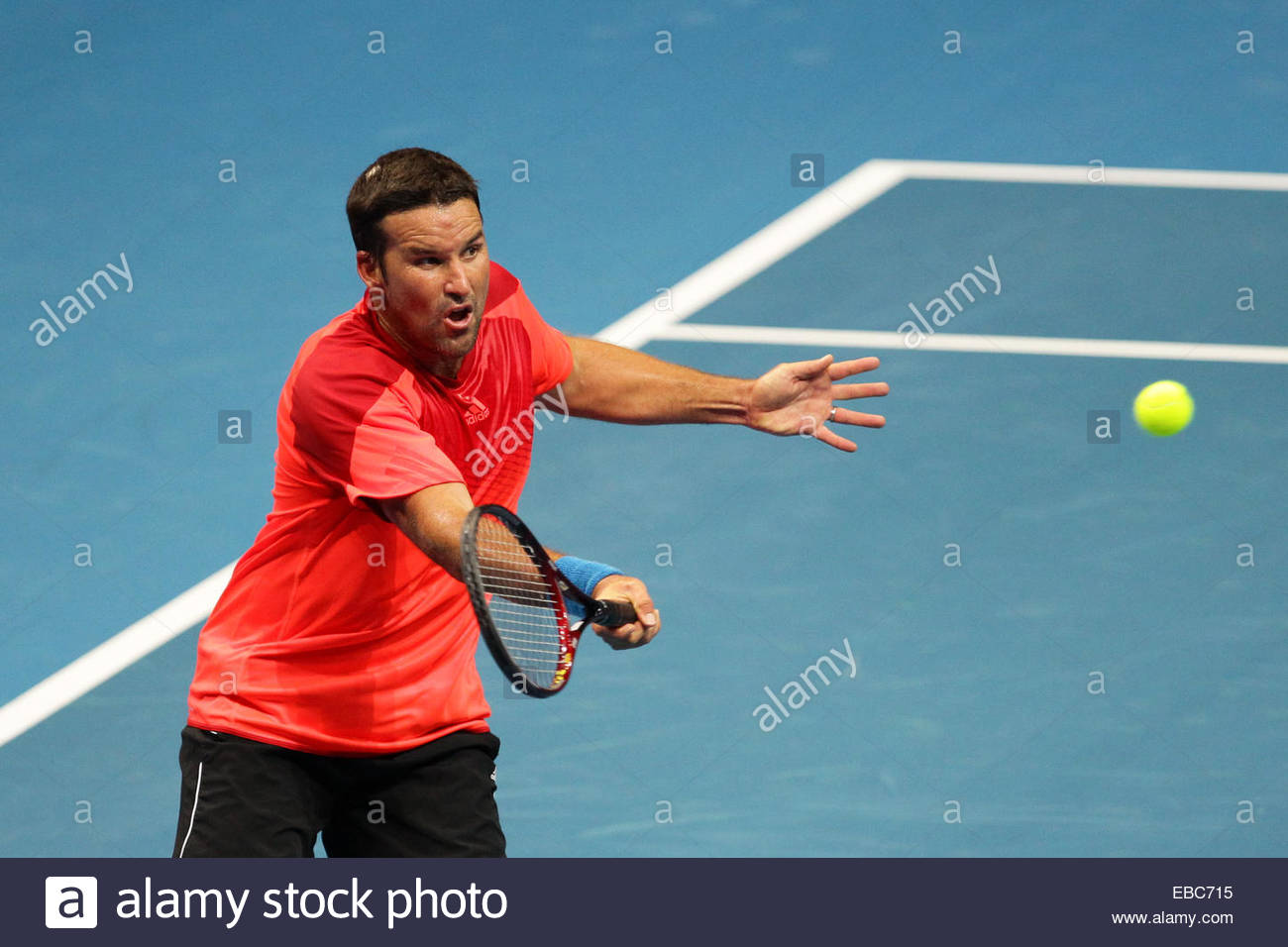 Patrick Rafter of the Singapore Slammers makes a forehand return