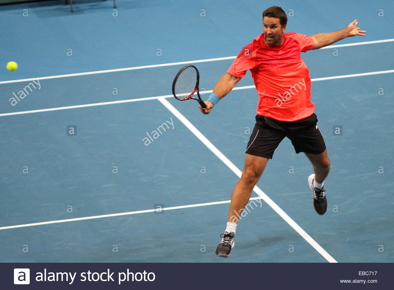 Patrick Rafter of the Singapore Slammers makes a backhand return