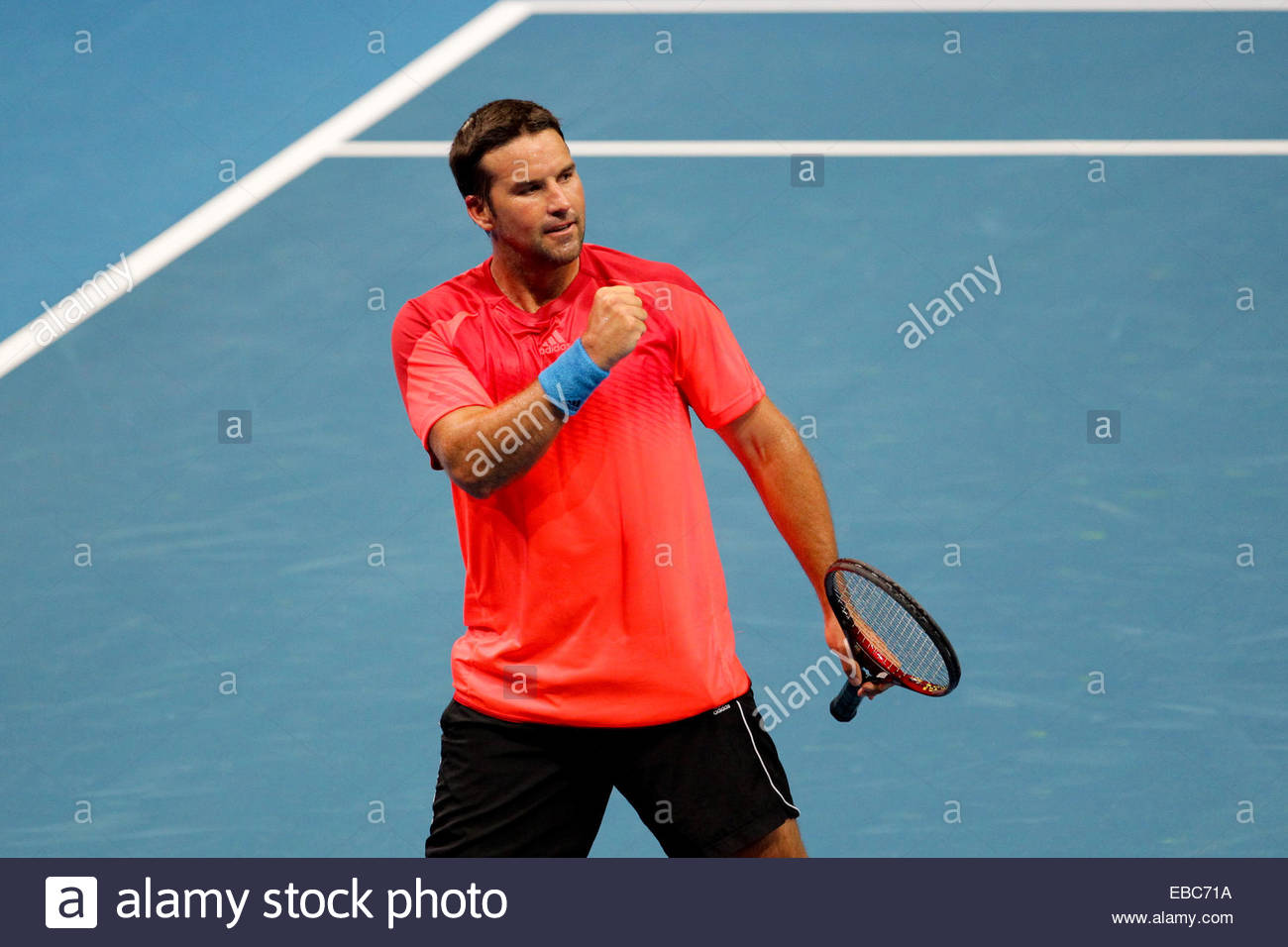 Patrick Rafter of the Singapore Slammers gestures after a point