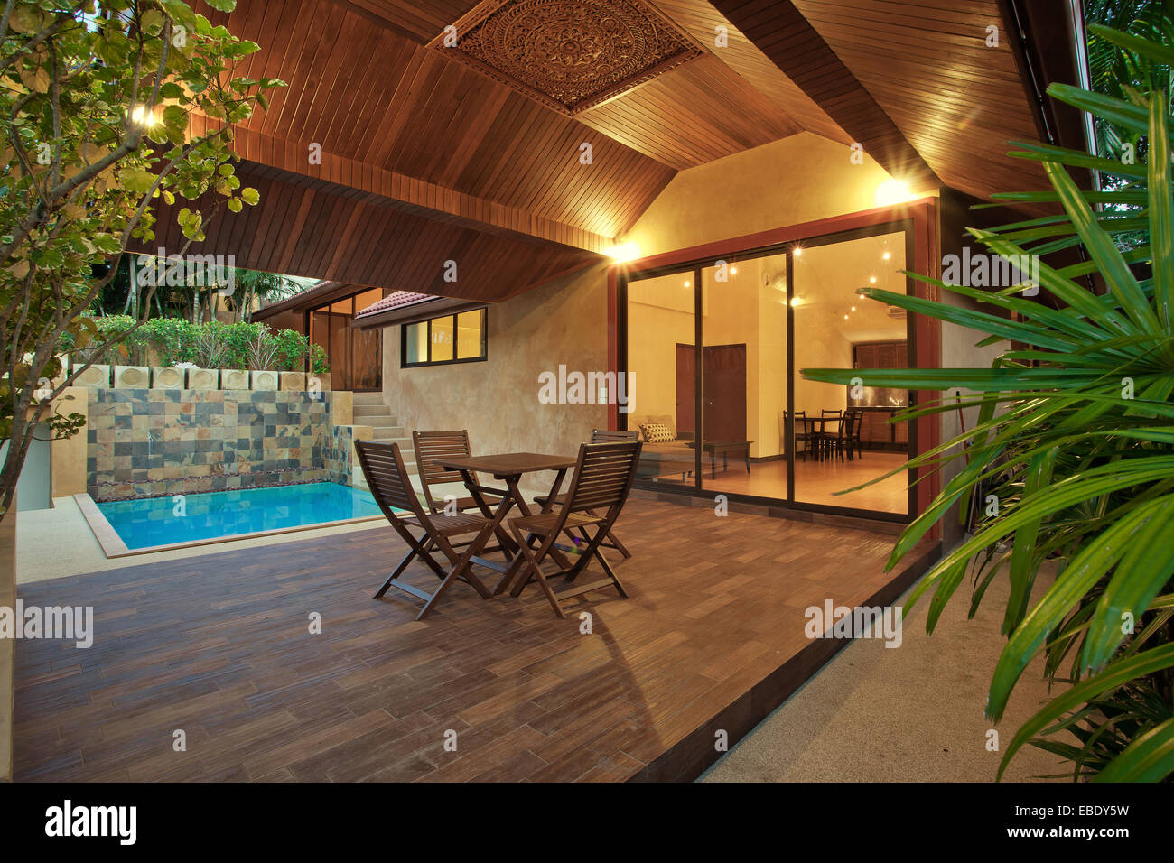 Stock Photo   Panoramic View Of Nice Summer House Patio With Swimming Pool