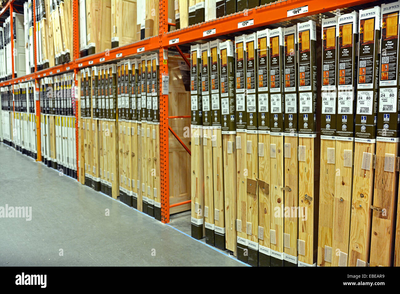 a row of many wooden doors for sale at home depot in college point stock photo royalty free. Black Bedroom Furniture Sets. Home Design Ideas